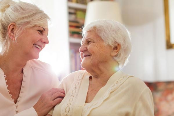 Senior and caregiver talking