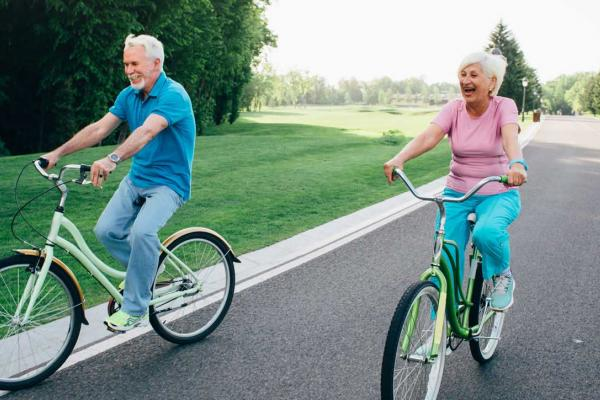 Two seniors riding their bikes
